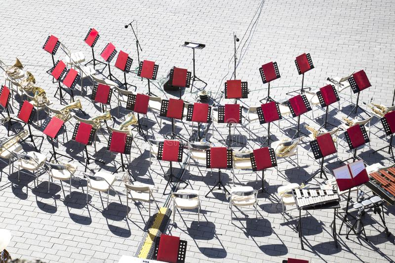 Top view of the chairs music stands brass band instruments. royalty free stock photography