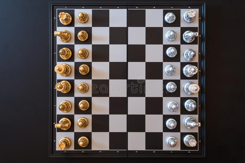 top view of chess pieces on a chessboard, business strategy concept stock photo