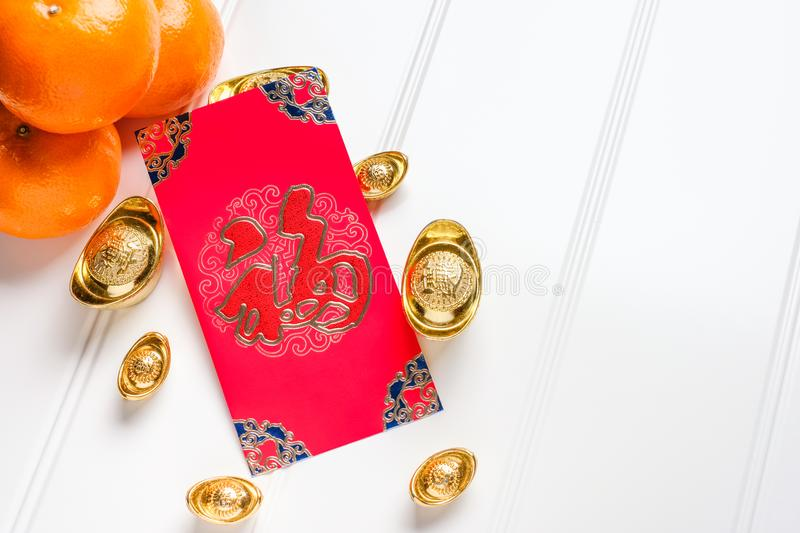 Top view Chinese New year red envelope packet ang pow with g royalty free stock image
