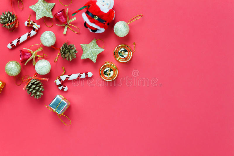 Top view Chrismas decoration and Santa Claus doll on red background with copy space. royalty free stock photography