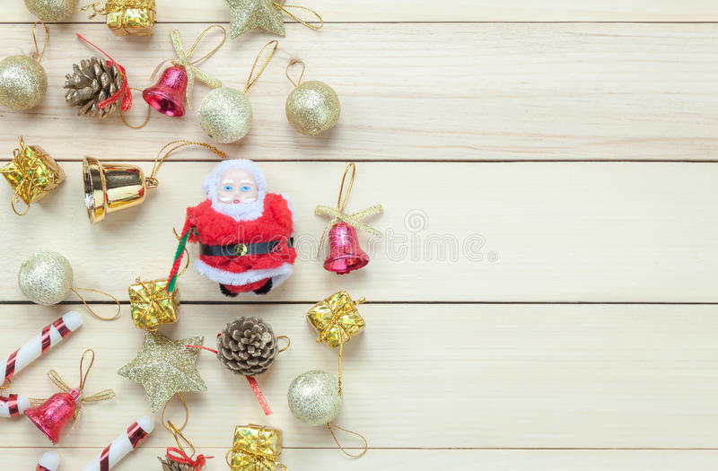 Top view Chrismas decoration and Santa Claus doll on wooden table with copy space. stock photo