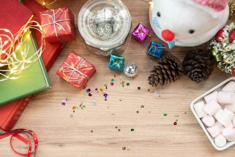 Top view of Christmas background with snowman, red gift or present boxes, on wooden table. royalty free stock photo