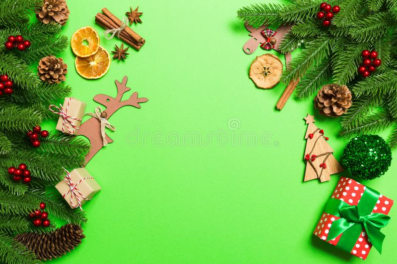 Top view of Christmas decorations on green background. New Year holiday concept with copy space stock images