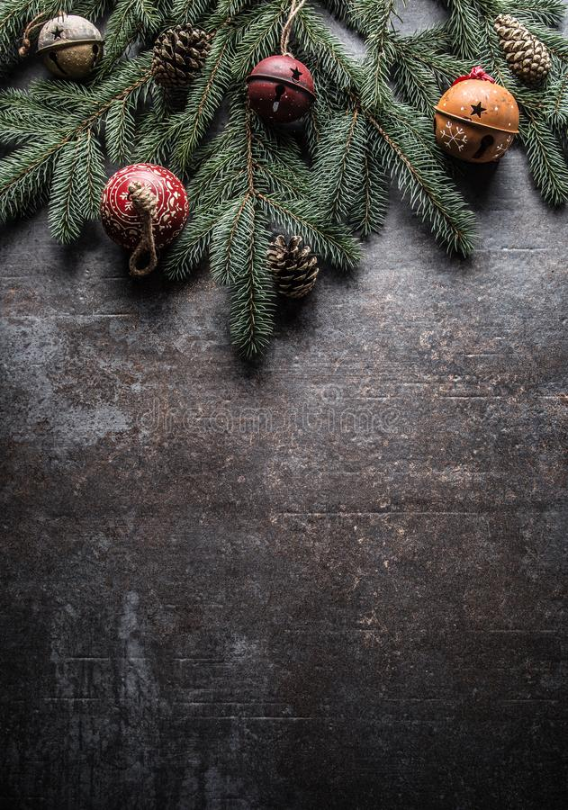 Top of view christmas decorations jingle bells fir tree pine cones on free concrete background stock photo
