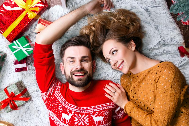 Young happy couple in love during Merry Christmas and Happy New Year holidays stock photos