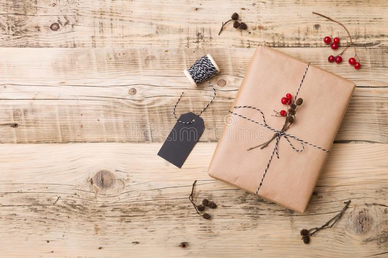 Top view on Christmas gift wrapped in craft and decorated with various natural things. DIY present idea.Holidays concept. Top view on Christmas gift wrapped in stock image