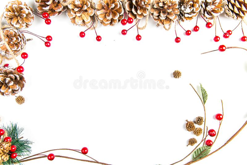 A top view of a Christmas ornaments: pine cones and branch with berries. royalty free illustration