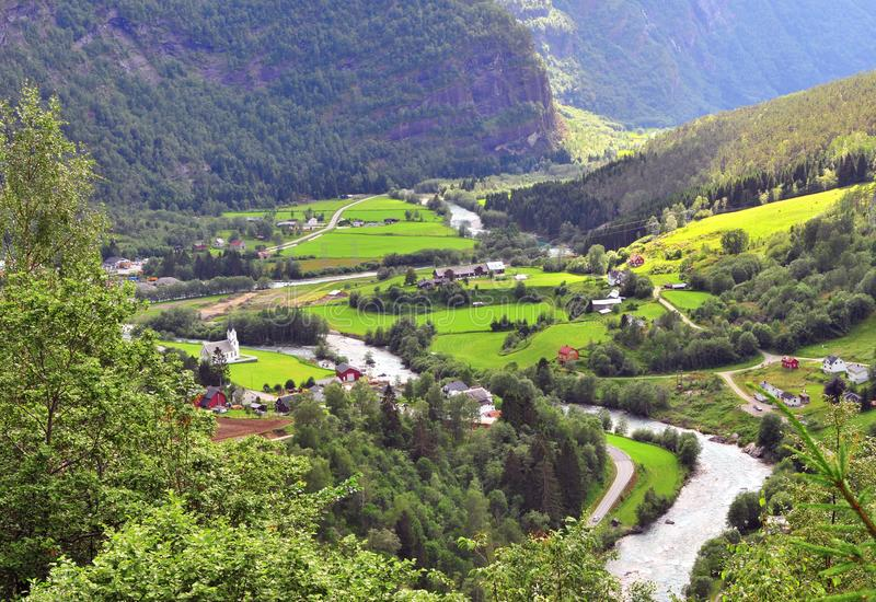 Top view of the church in green valley with winding river. Geiranger, Norway royalty free stock photo