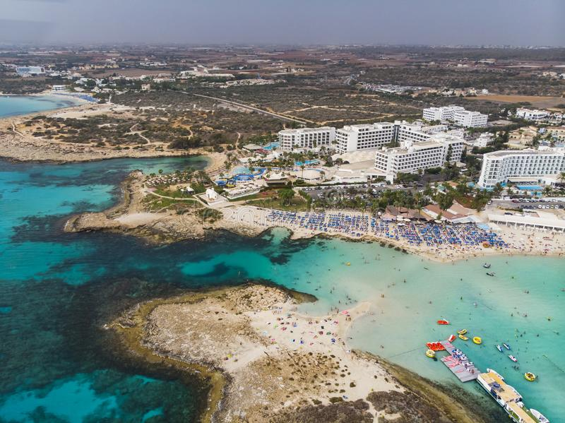 Top view of city of Cyprus and the city of Ayia NAPA. Air view of the resort Mediterranean coastal city. Tourist town. Nissi Beach. Top view of the city of royalty free stock image