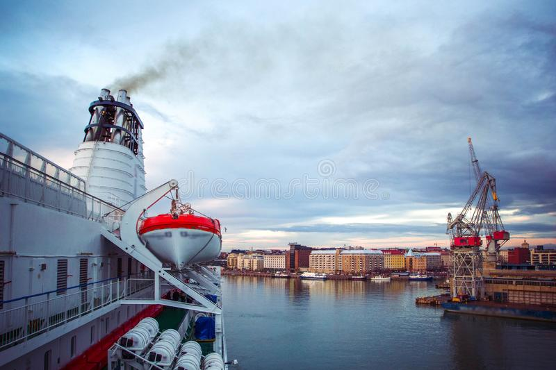 Top view of city of Helsinki and business port with international transportation with shipping cargo, ships, containers in morning royalty free stock photo