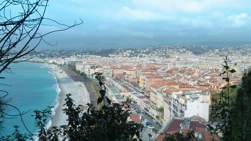 Top view on the city nice france. Landscape and azure sea with beach walking people riding cars on the road tourist town in spring season.time lapse royalty free stock photos