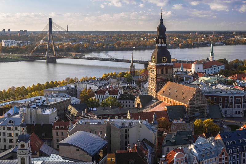 Top view of the city of Riga at sunset. Autumn view of the city of Riga at sunset. View from the city's main tower of the city, river and bridges royalty free stock images