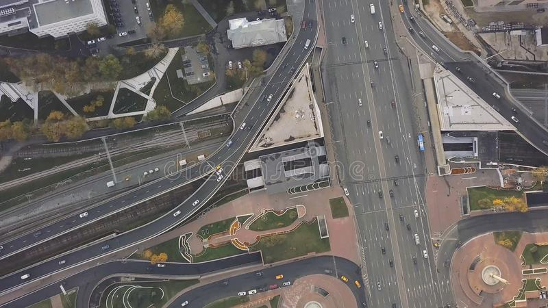 Top view city traffic of highway, logistics. Clip. Aerial top view of road junction from above, automobile traffic and royalty free stock photos