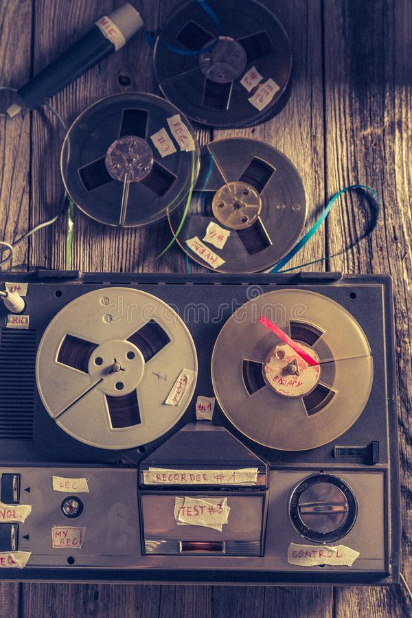 Top view of classic reel audio recorder. On wooden table stock images