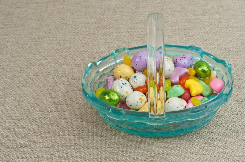 Glass, easter basket of candy stock photos