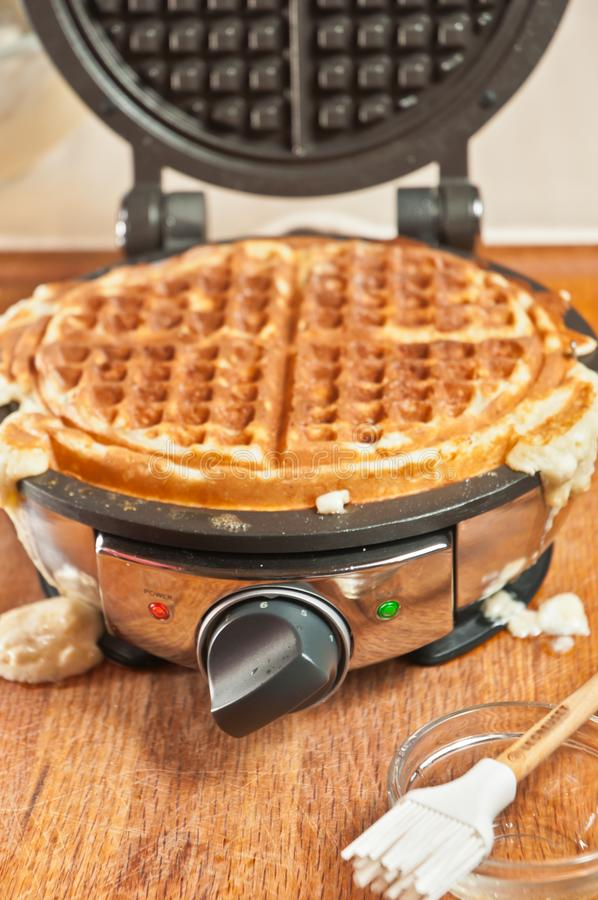 Grilled waffle in waffle maker royalty free stock images