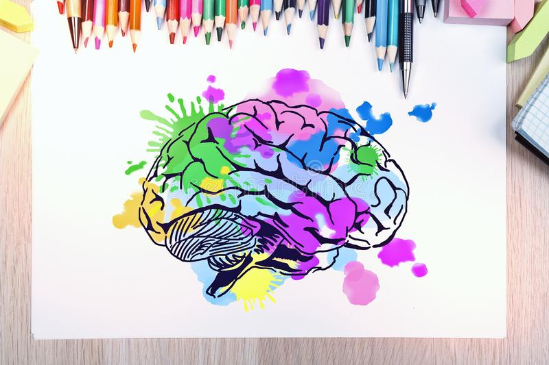 Brainstorm and art concept. Top view and close up of desktop with creative brain sketch. Brainstorm and art concept royalty free stock photos