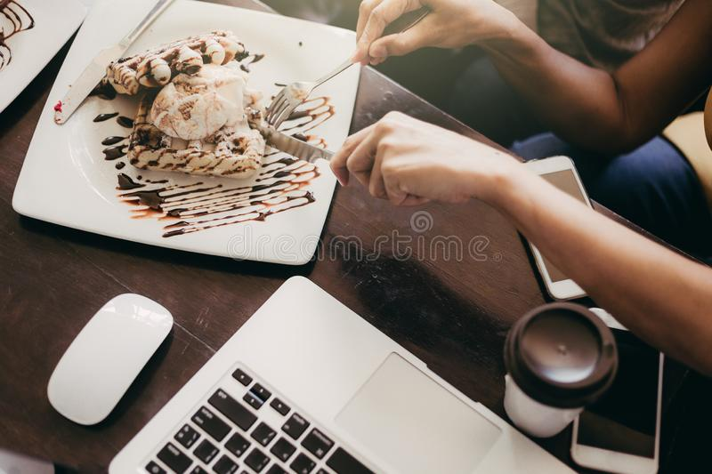 Top view Close up hand Young Woman and men meet at the Cafe. stock photo