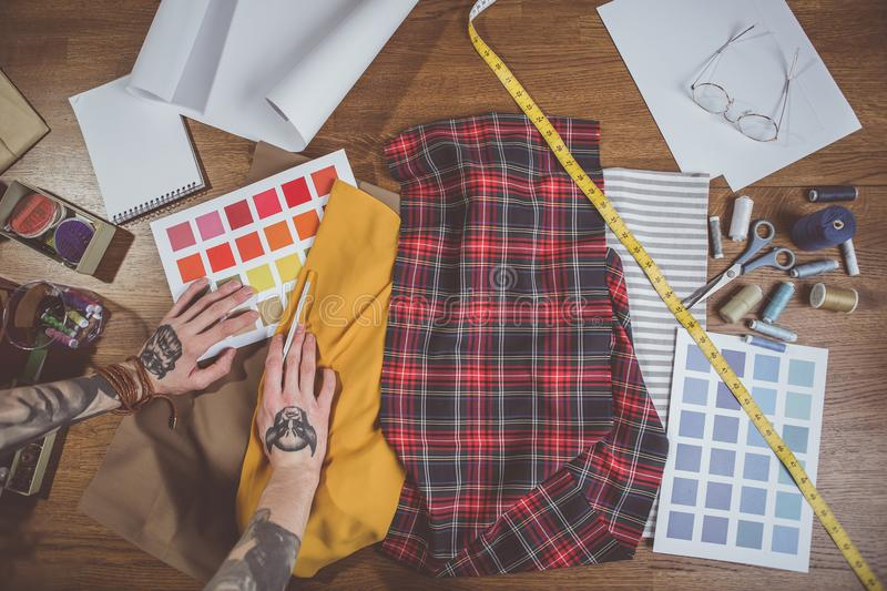 Man arms working with palette and fabric royalty free stock photo