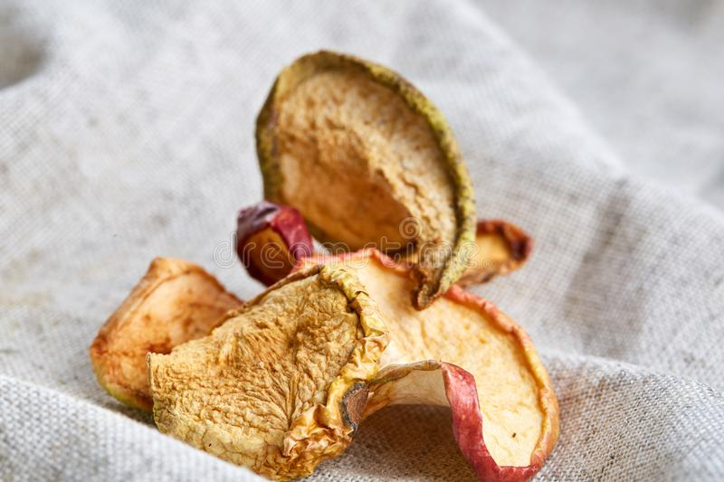 Top view close-up picture of dried apples on light cotton tablecloth, selective focus. stock images