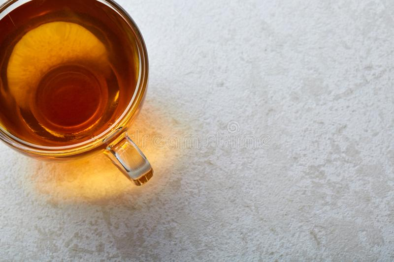 Top view close up picture of tea in transparent cup isolated on white marble background, shallow depth of field. royalty free stock photo