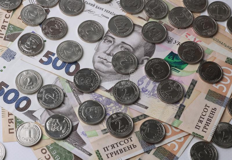 Top view, close-up of Ukrainian money with a face value of 500 hryvnia and coins of 2 hryvnia. Background made of money. Background made of money. Wealth royalty free stock photography