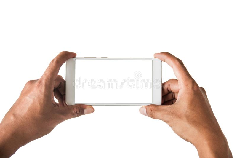 Top view,Closed up Hands grip capture blank space smart phone wi stock photo
