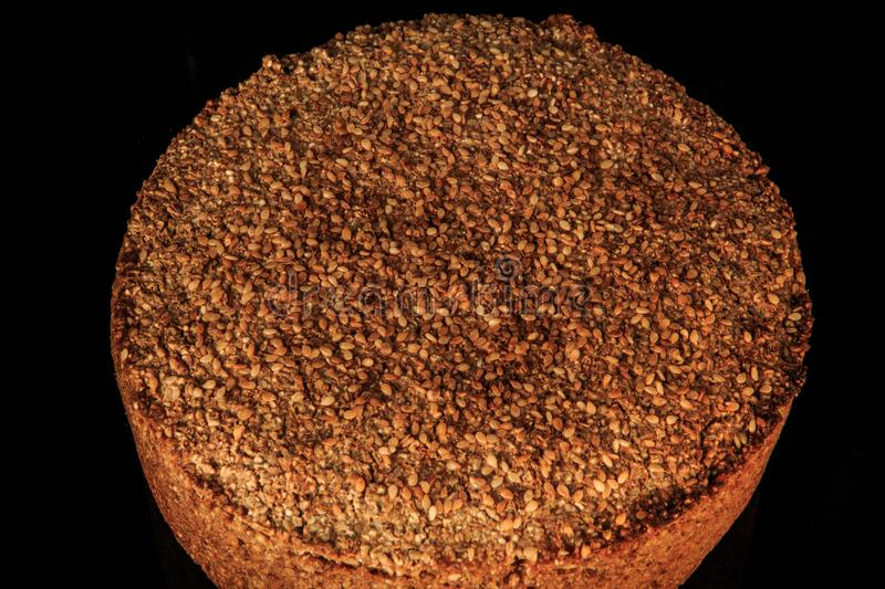 top view closeup whole round baked rye wheat bread with sesame seeds stock photos