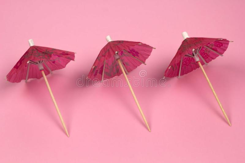 cocktail umbrellas pattern pink background royalty free stock photos