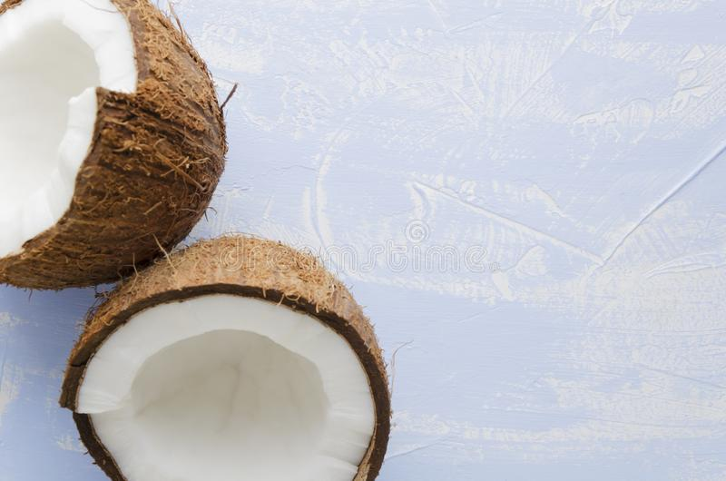Top view of coconut halfs on blue background.Copy space, closeup stock image