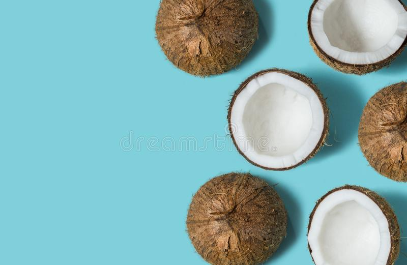 Top view of coconut isolated on blue background Summer concept. Flat lay. Pattern. stock images