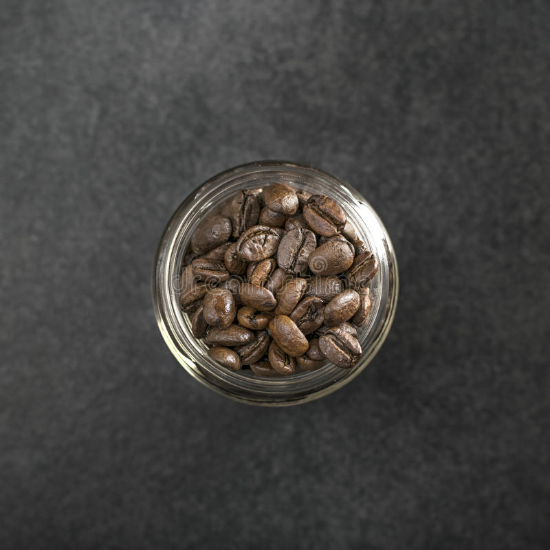 Top view of coffee beans in jar stock photography