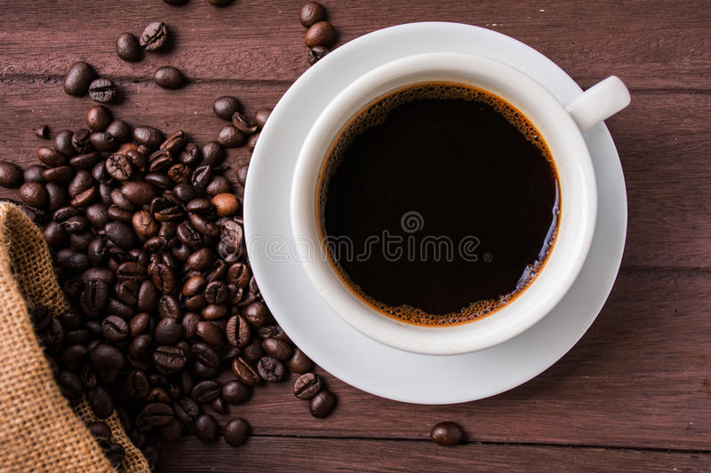 top view coffee cup and coffee beans on table stock image image of roasted background 77902115. Black Bedroom Furniture Sets. Home Design Ideas