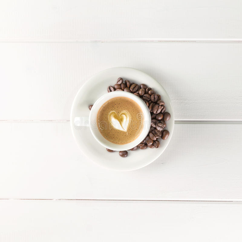 Top view coffee cup white beans stock photo