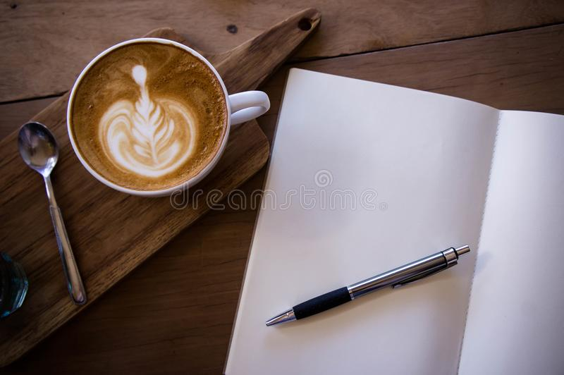 Top view coffee latte aroma cup and tasty christmas cake relaxtime waiting for idea on paper note on wood table in cafe coffee sh stock photography