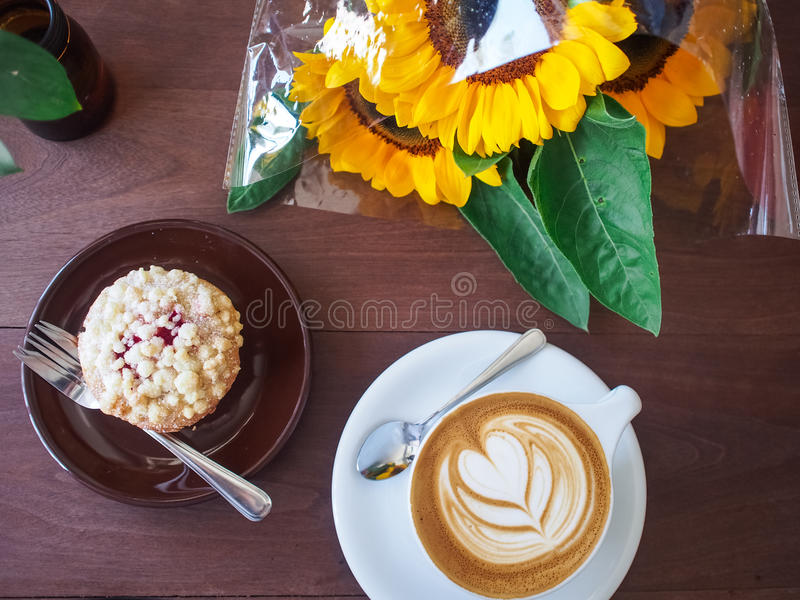 Top view coffee latte art on wood table with cookie. stock photos