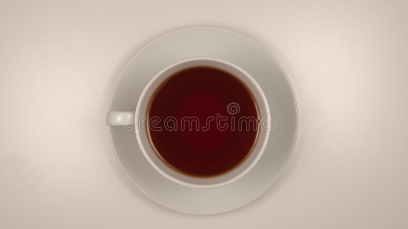 TOP VIEW: Coffee in a white cup on a desk stock photos
