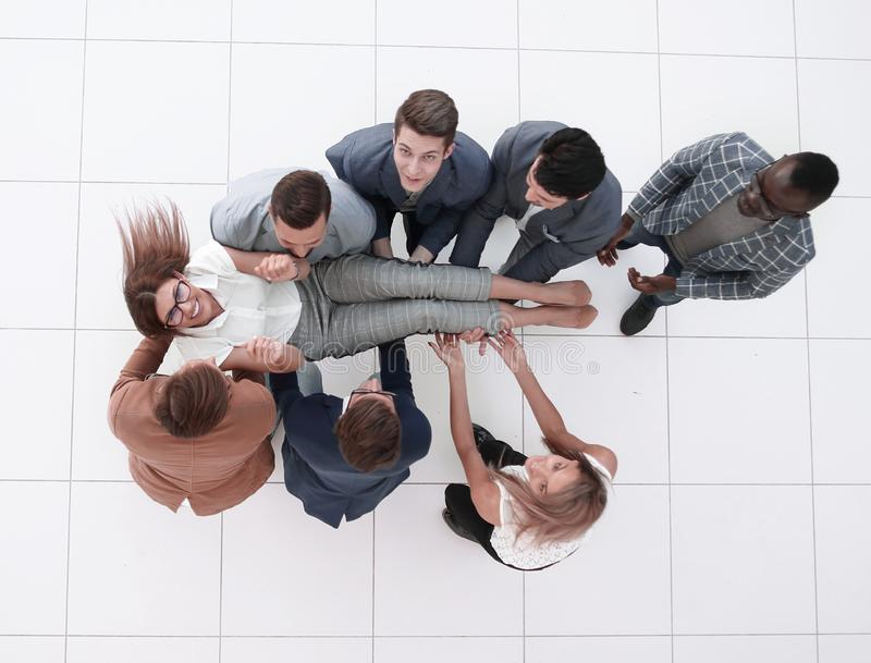 Top view.colleagues throws the project Manager royalty free stock photo