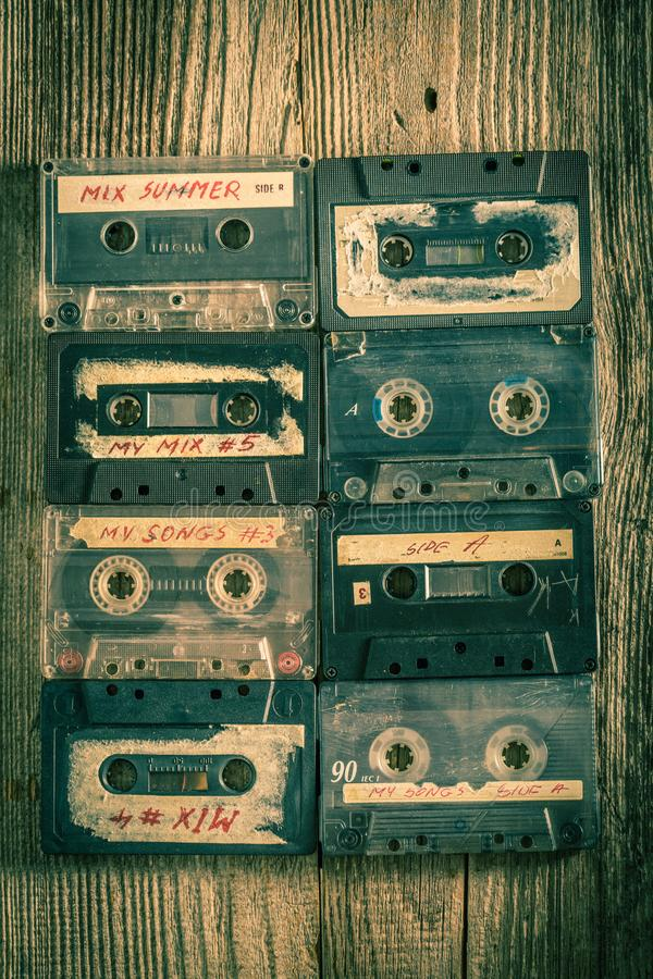 Collection of retro cassette tapes places in a grid stock images