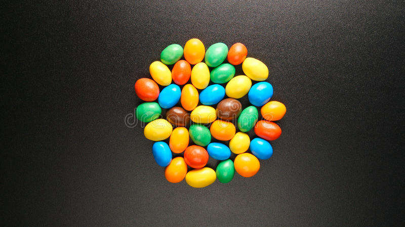 TOP VIEW: Coloful candies on a black table royalty free stock photography