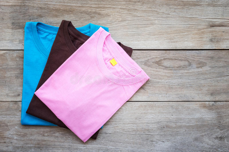 Top view of color T-Shirt on grey wood plank stock images