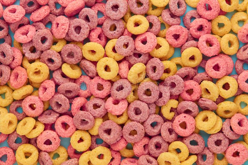 Overhead view of colorful cereal rings stock images