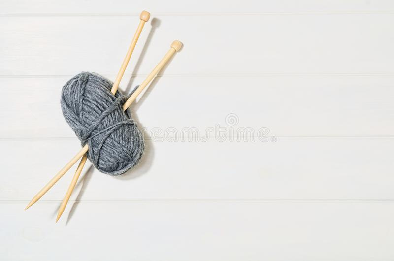 Knitting accessories top view on white wooden background royalty free stock photos