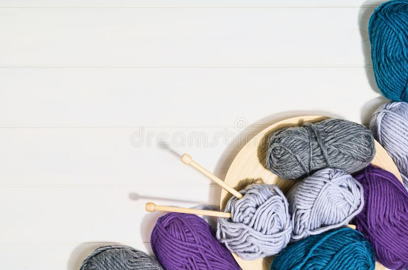 Knitting accessories top view on white wooden background royalty free stock photo