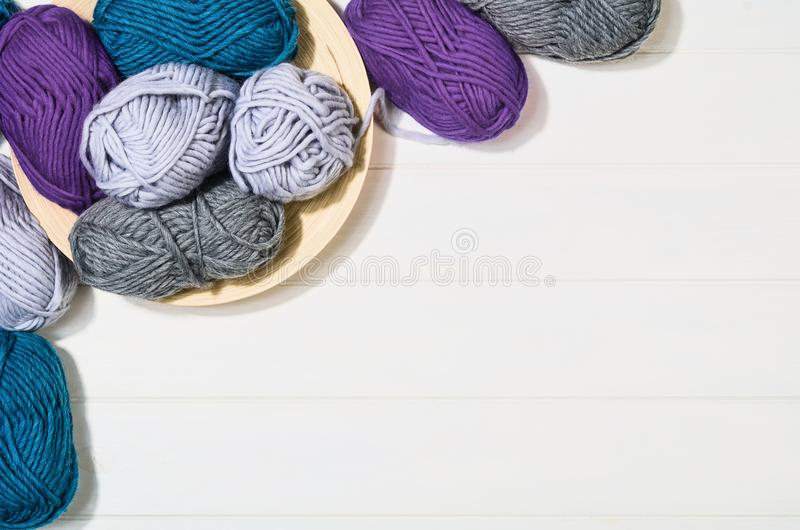 Knitting accessories top view on white wooden background royalty free stock photography