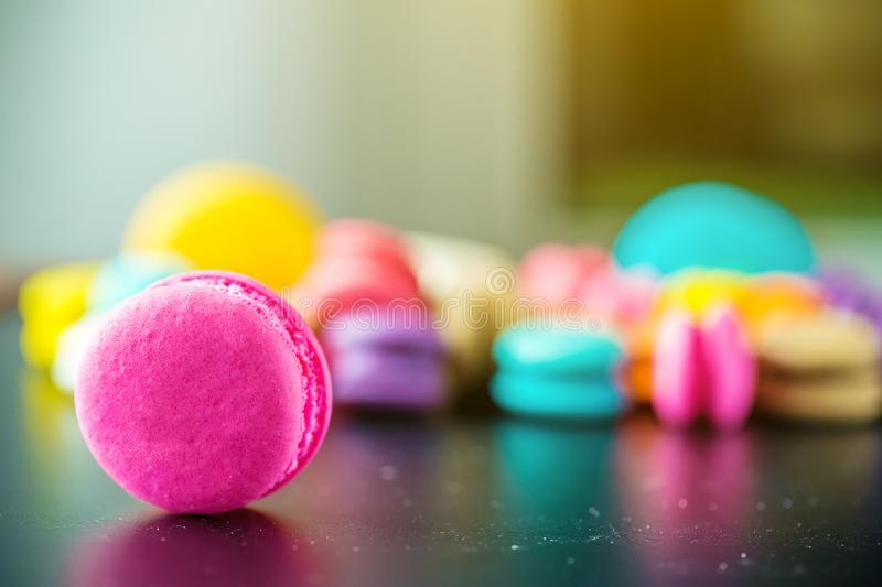 Top view colorful macarons dessert with vintage pastel tones. Colorful french macarons background,Different colorful macaroons background.Tasty sweet color royalty free stock photography