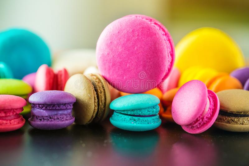 Top view colorful macarons dessert with vintage pastel tones. Colorful french macarons background,Different colorful macaroons background.Tasty sweet color stock image