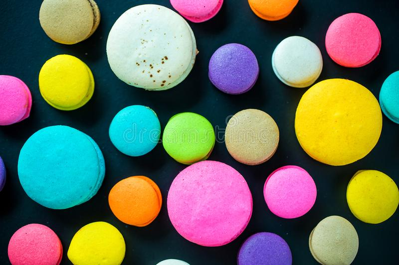 Top view colorful macarons dessert with vintage pastel tones. Colorful french macarons background,Different colorful macaroons background.Tasty sweet color stock photos