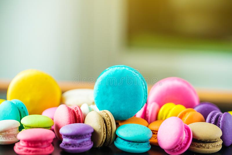Top view colorful macarons dessert with vintage pastel tones. Colorful french macarons background,Different colorful macaroons background.Tasty sweet color royalty free stock image