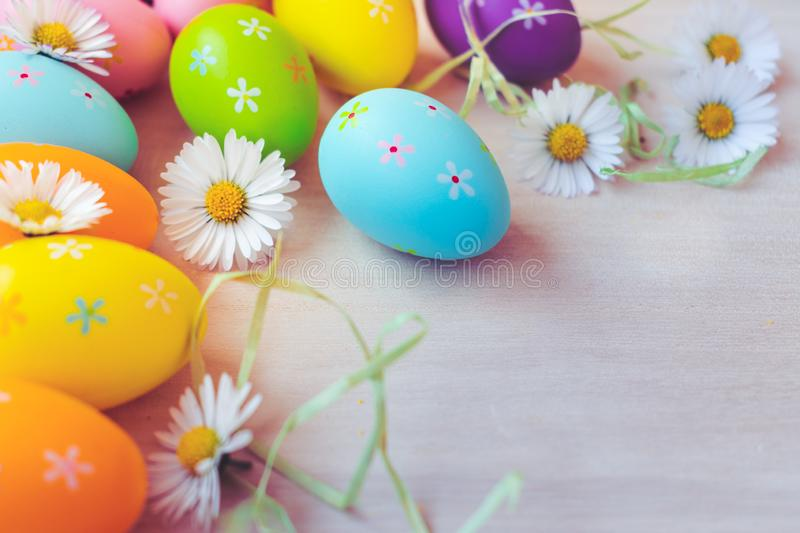Top view of colorful Easter eggs decorations and dandelions on wooden background royalty free stock photos